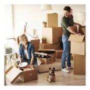 couple unpacking with dog